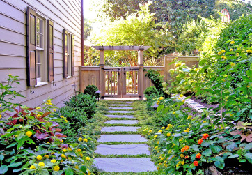 Wood arbor and gate creates welcoming entrance to rear yard