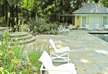 Pool deck surrounded by garden plantings
