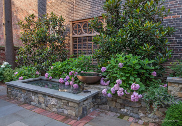 Lower fountain and patio surrounded by planting