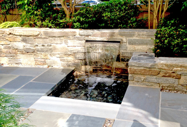 Patio fountain with stone wall and bluestone patio