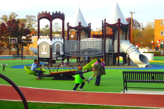 Children playing among play equipment