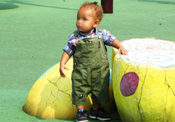 Close-up of toddler playing at the dragon egg equipment