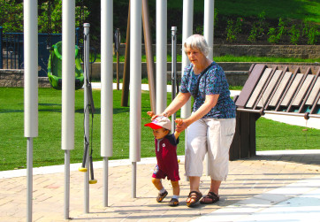 Grandmother and grandson exploring the musical play area