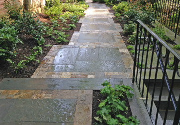 Rich warm colors frame stone panels on this shady side path