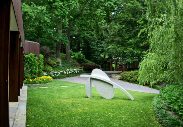Sculpture is positioned in a front lawn panel to capture guests attention upon arrival