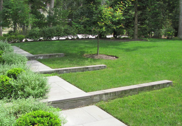 A refined series of steps and retaining walls address a sloping front lawn