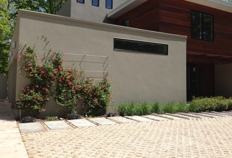 The permeable pavers of this drive allow for water to percolate into soil