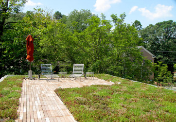A green roof provides an usual urban oasis for the homeowners of this zero net energy LEED Platinum property
