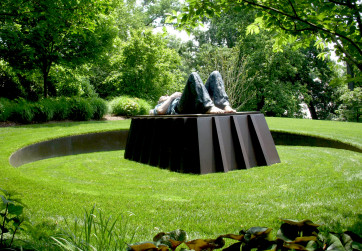 CorTen steel retaining wall surrounding sculpture