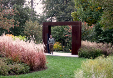 Modern meadow in fall with sculpture